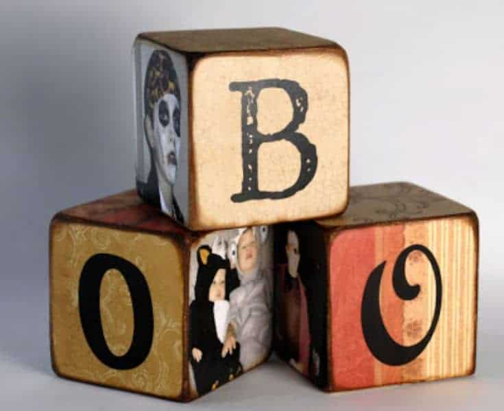 wooden blocks with images and letters forming a word boo