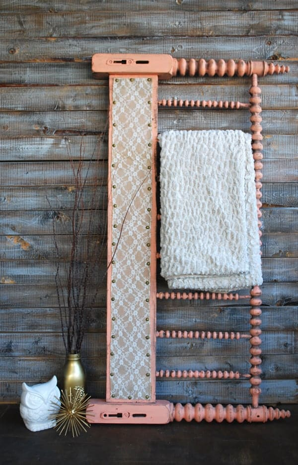 Old headboard turned into a quilt rack on a wooden background