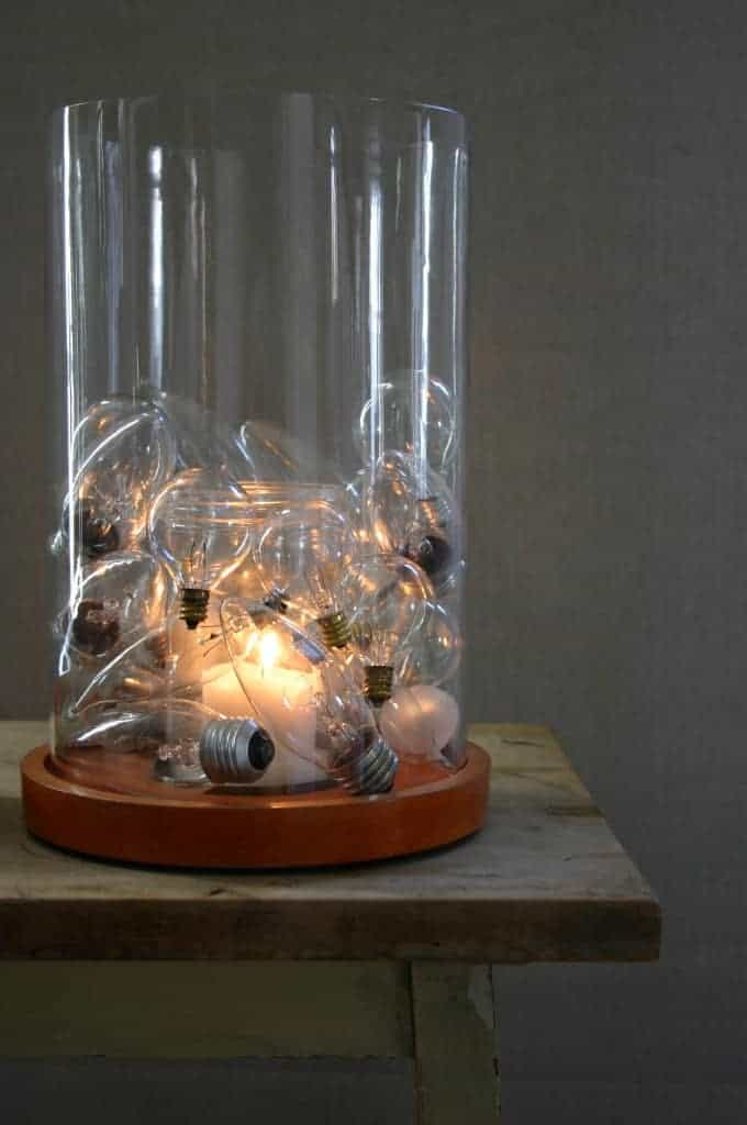 Ols light bulbs inside of a glass candle holder