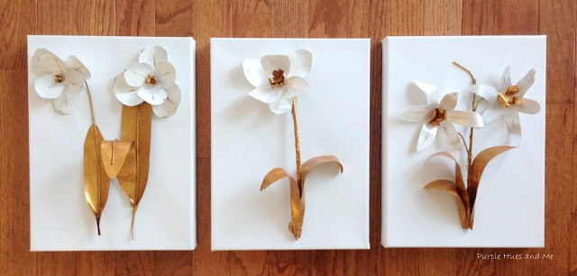 Three canvas with flowers made out of soda cans