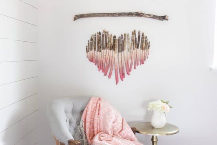 wall art made of sticks in a heart shape