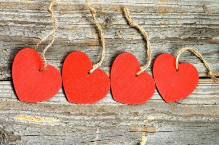 4 red heart on a wooden background